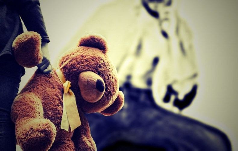 Image of a teddy bear that alludes to abuse