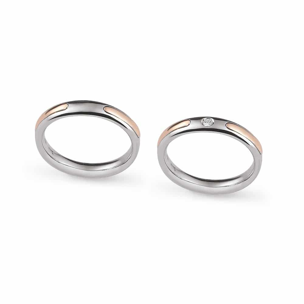 Modern bicolor gold wedding ring with lateral insert with