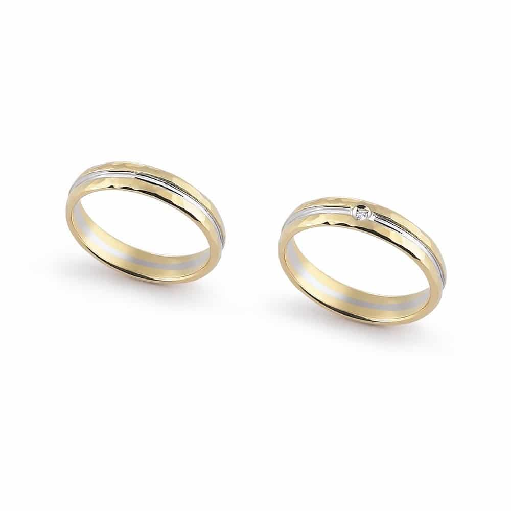 Modern bicolor gold wedding ring with faceting with or