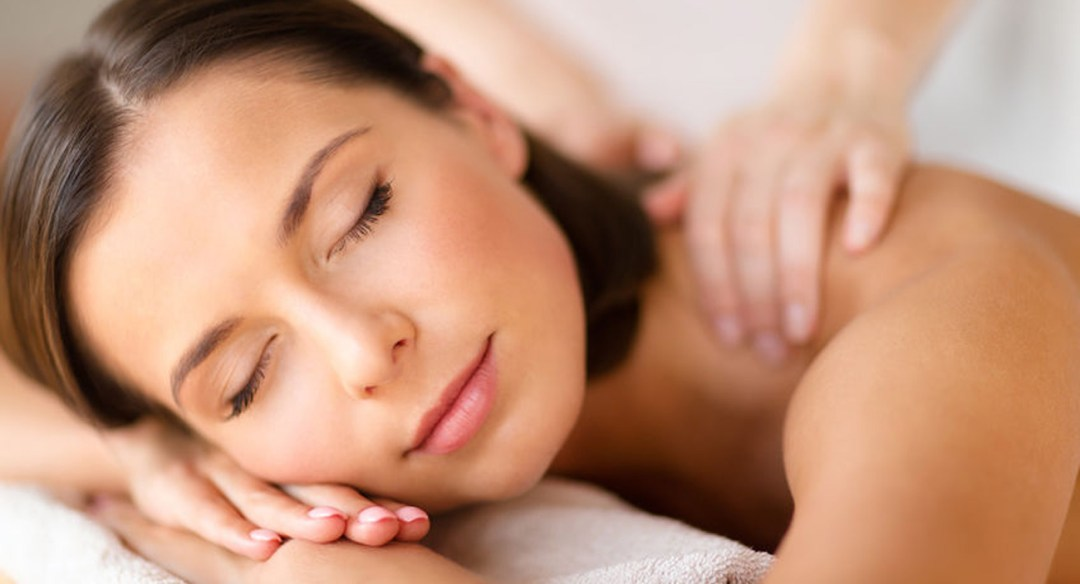 Woman during massage therapy session.