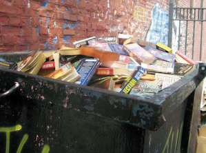 books in a dumpster