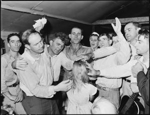 1280px-Healing_'laying_on_of_hands'_ceremony_in_the_Pentecostal_Church_of_God._Lejunior,_Harlan_County,_Kentucky._-_NARA_-_541337