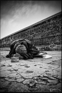 beggar at a wall