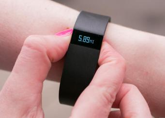 person checking the activity indicator on their fitness band