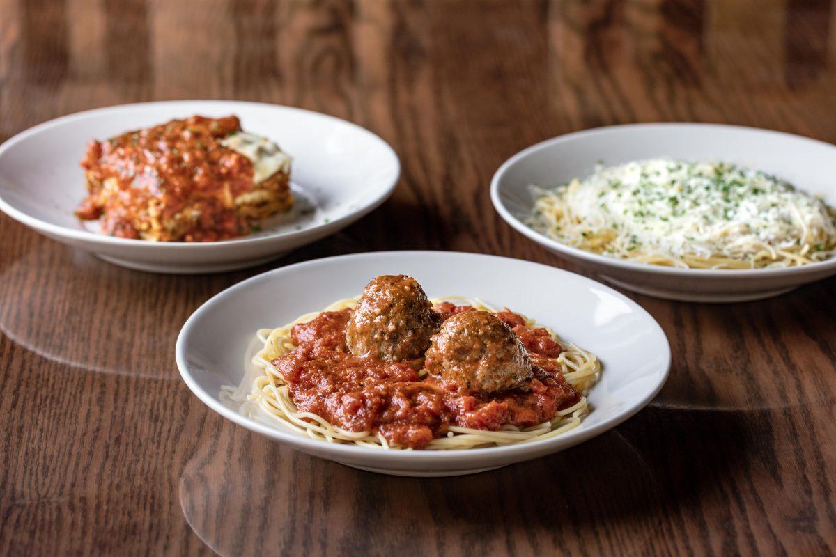 three plates: lasagna, spaghetti and meatballs, and mizithra pasta at The Old Spaghetti Factory