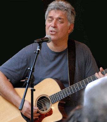 Peter Makena playing guitar