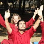 meditators with hands in air - Oshodham
