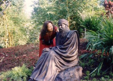 Vinit next to Osho sculpture in Osho Teerth Park