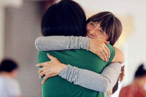 300 hug with Meera cr Ananda Heech