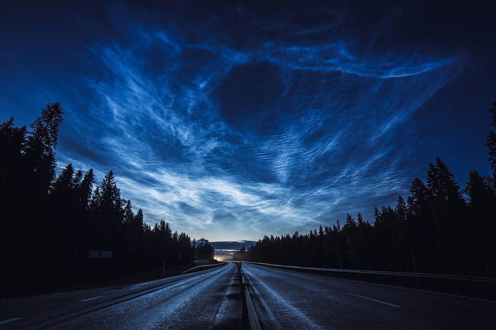 Noctilucent clouds stretch across the Swedish sky