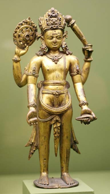 A statue of Vishnu, with the Sudharshana Chakra in his upper right arm.