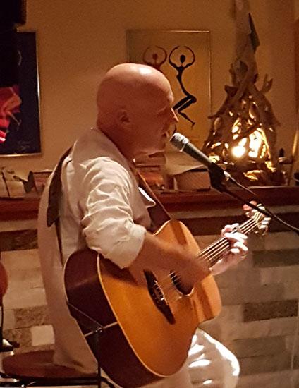 Nadama singing his songs in an informal setting