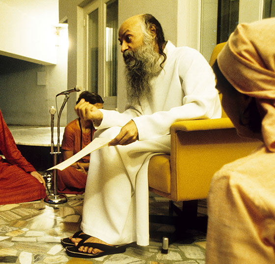 Osho in darshan giving initiation