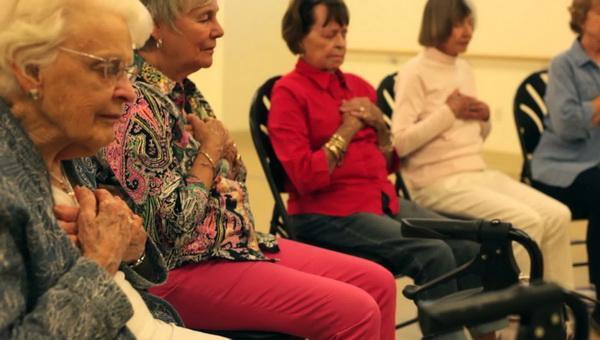 Elderly people meditating