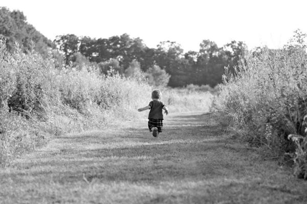 Child running on path