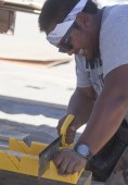 Rolland Tizuela works on the boat for the 'Merman' team