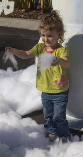 Sophia Burgess plays with the artificial snow