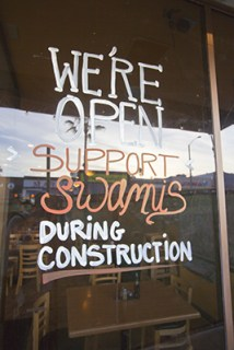 Business owners are doing what they can to let people know they are open during construction