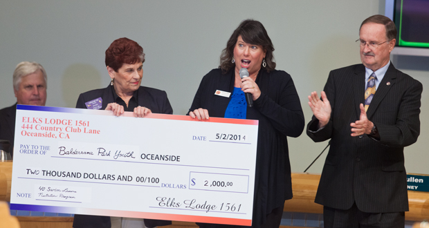 Carole May with the Oceanside Elks presents Eileen Turk, Parks and Recreation Division Manager , with a $2,000.00 donation