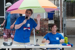 CJ Conard and Barbara Kozam, announcers at one of five stations along the parade route