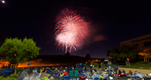 People lined the streets near the El Corazon Senior Center for the fireworks show on Thursday.