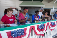 Judges, Eileen Bessent, Xye Sanders, Ann Marie White and Vatei Campbell tally the scores for the parade entrants