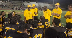 First year head coach, John Roberts (left) talks to the team after their season opening loss.