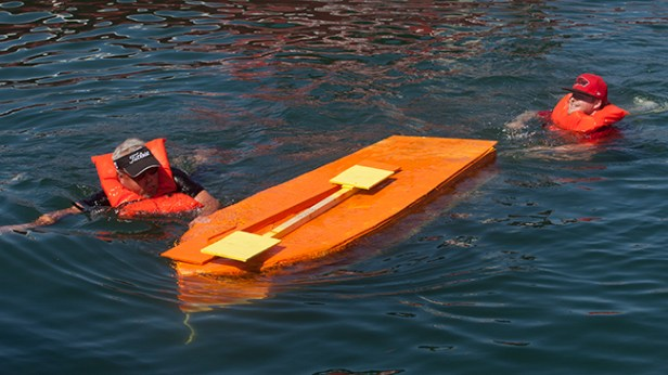 "Aaron and Mike Robinson swim back to the dock, with boat in tow, in what Mike called ""Nail and Fail number 5"""