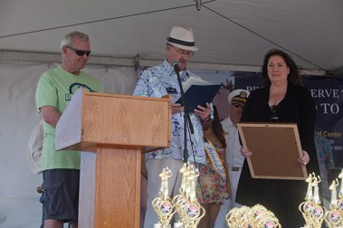 David Nydegger and Mayor Jim Wood give a proclamation to Katherine Wyeste-Reilly dedicating the 2014 Harbor Days in honor of her grandfather, Aaron Skalar