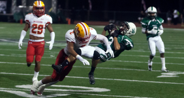 Grumbling holds on to the ball after getting hit hard by a Mission Viejo Diablos Free Safety Julian Owens
