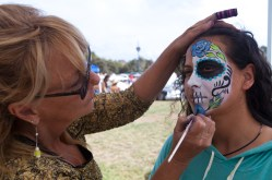 Susan Marchu, owner of SuSu's Body Art face-paints Rosa Valdovinos