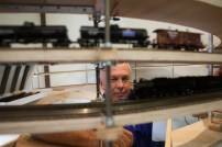 Harold Helland, President of the North County Model Railroad Society watches as trains ran for the first time on the layout at the society's new location at Heritage Park