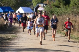 Andy Thacher of Mira Mesa leads the pack from the start line. He also crossed the finish line first.