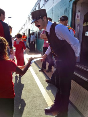Robert Nathan greets young passengers as they board the Coaster Holiday Express (file photo)