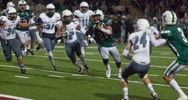 Oceanside's Josh Bernard goes up the middle for the Pirates first touchdown of the night.