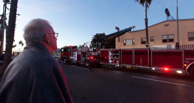 Dolphin Hotel Resident, Alan Fredrick watches firefighters at work