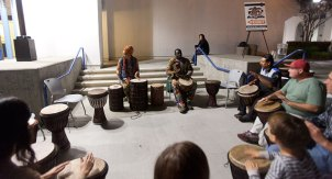 Drum instruction in front of the library