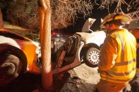 Oceanside Battalion Chief, Peter Lawrence inspects the vehicle after the extrication