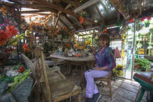 Loren Dixon with a tea set  in the Fairy Cottage