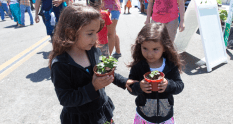 Alaina 5, and Gracie, 3 were anxious to get home and water the plants they got from the MiraCosta College Horticultural booth