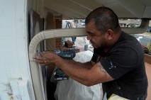 Jorge fixes a drain pipe