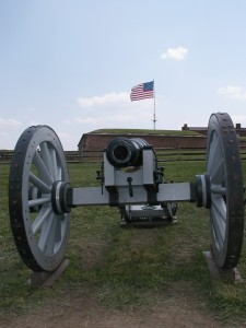 An oversize flag flying over Baltimore's Fort McHenry, similar to the one guarded here by a cannon, was the inspiration for our national anthem. – Cecil Scaglione photo
