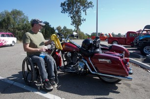 Brad Byrom polishes his 2006 Harley-Davidson Road King and side car. He has been riding the specially outfitted bike since it was new
