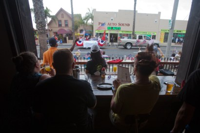 Watching the parade from the comfort of the Local Tap House and Kitchen. One of several places to watch the parade and enjoy breakfast along the parade route.
