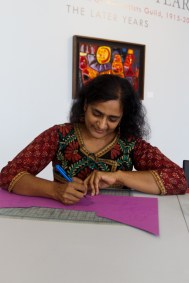 Bhavna Mehta cutting paper for her upcoming installation at the Oceanside Museum of Art