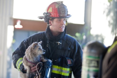 Captain Tim Scott with one of the rescued dogs
