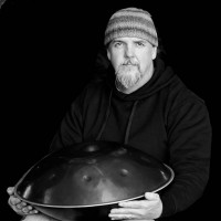 Ray Ford with his hang drum (courtesy photo) Click on image to enlarge photo.