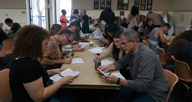 People filling out paperwork during open casting