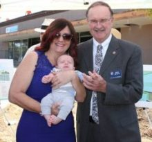 Julie Lowen, CEO of Children's Paradise Preschool and Infant Centers, two-month-old and future Children's Paradise student, Grahm Ewing and Jim Wood, Mayor of the City of Oceanside. (courtesy photo)