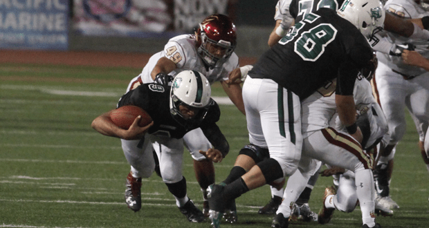 Pirate QB Max Shuffer dives for a first down to keep a third quarter scoring drive going